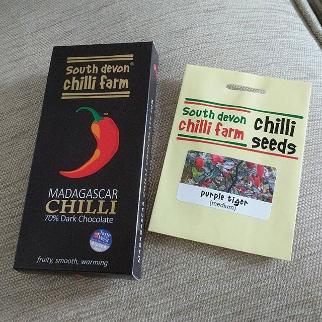 """This year I tried to grow my own chillies alongside a bunch of other vegetables and plants I had great success with like courgettes and sweet peasSadly none of my purple tiger chilli seedlings survived past 1"""" I wrote to #southdevonchillifarm to ask if they would send me another packet to try again next year and my prayers were answered  they even sent me a free bar of chocolate to stuff my face with  how very kind of them! Whoever said 'shy bairns get nowt' was a load of rubbish eh?#growingstuff #greenfingers #shybairns #plantmomma #nomnomnom"""